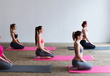 Women sitting on yoga mats