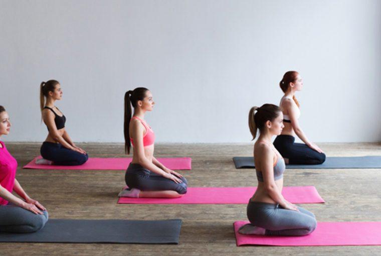 Women sitting on yoga mats