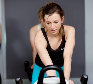 woman riding an indoor spin bike