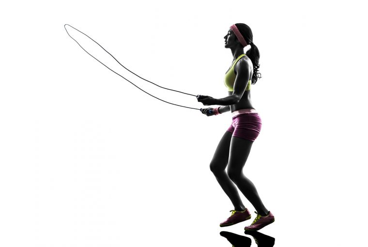 woman exercising with a skipping rope