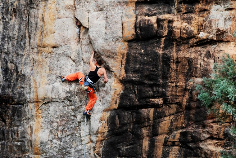 woman rock climbing in the mountains