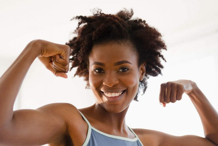 woman posing while flexing her muscles