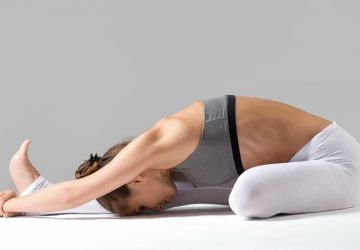 woman doing a yoga stretch