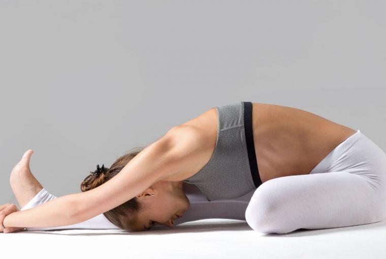 woman doing a yoga stretch