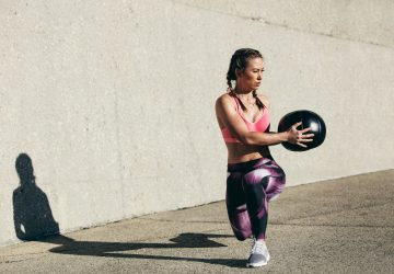woman doing a workout with a medicine ball