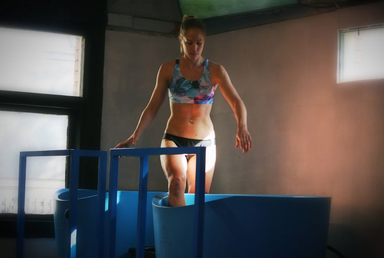 woman stepping into an ice bath