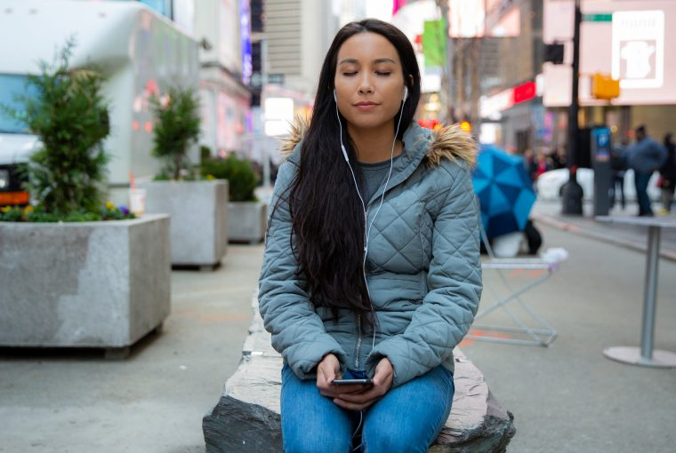 a woman meditating in public