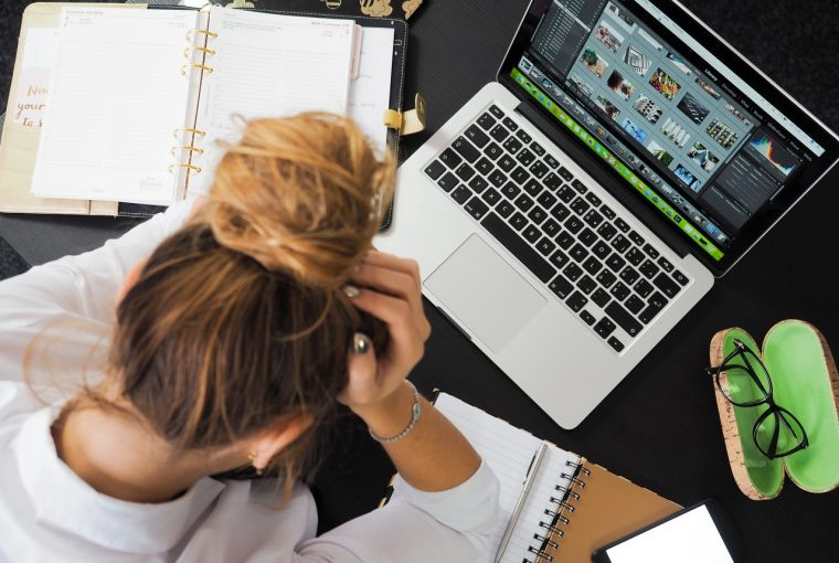 a woman stressed looking at her computer