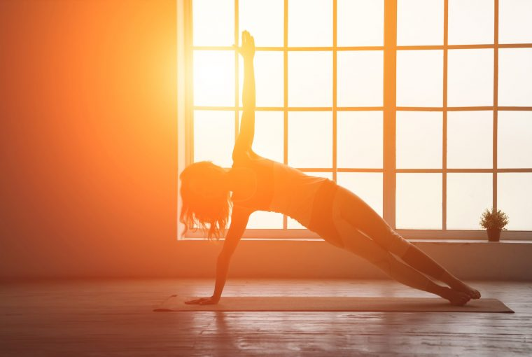 a woman doing yoga in the sunshine