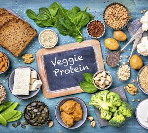 Vegan protein sources. Top view on a blue wooden background