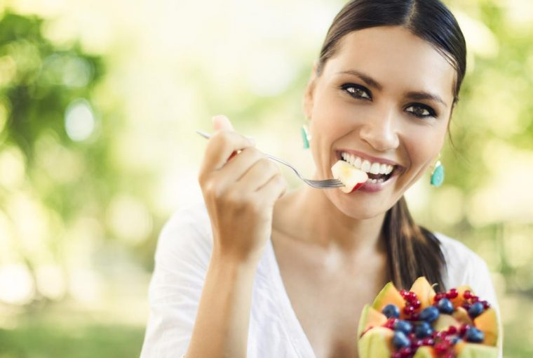 a woman eating a healthy meal