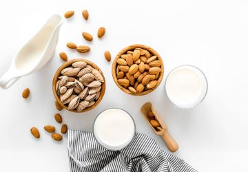 an assortment of nuts and nut milks