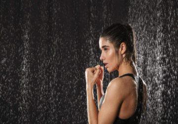 a woman working out in a shower